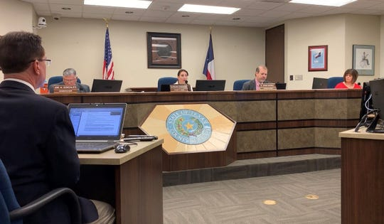 Nueces County commissioners vote on Feb. 6, 2019 to adopt a resolution against a recent proposal from a coalition in San Patricio County to increase the number of seats on the Port of Corpus Christi Commission.