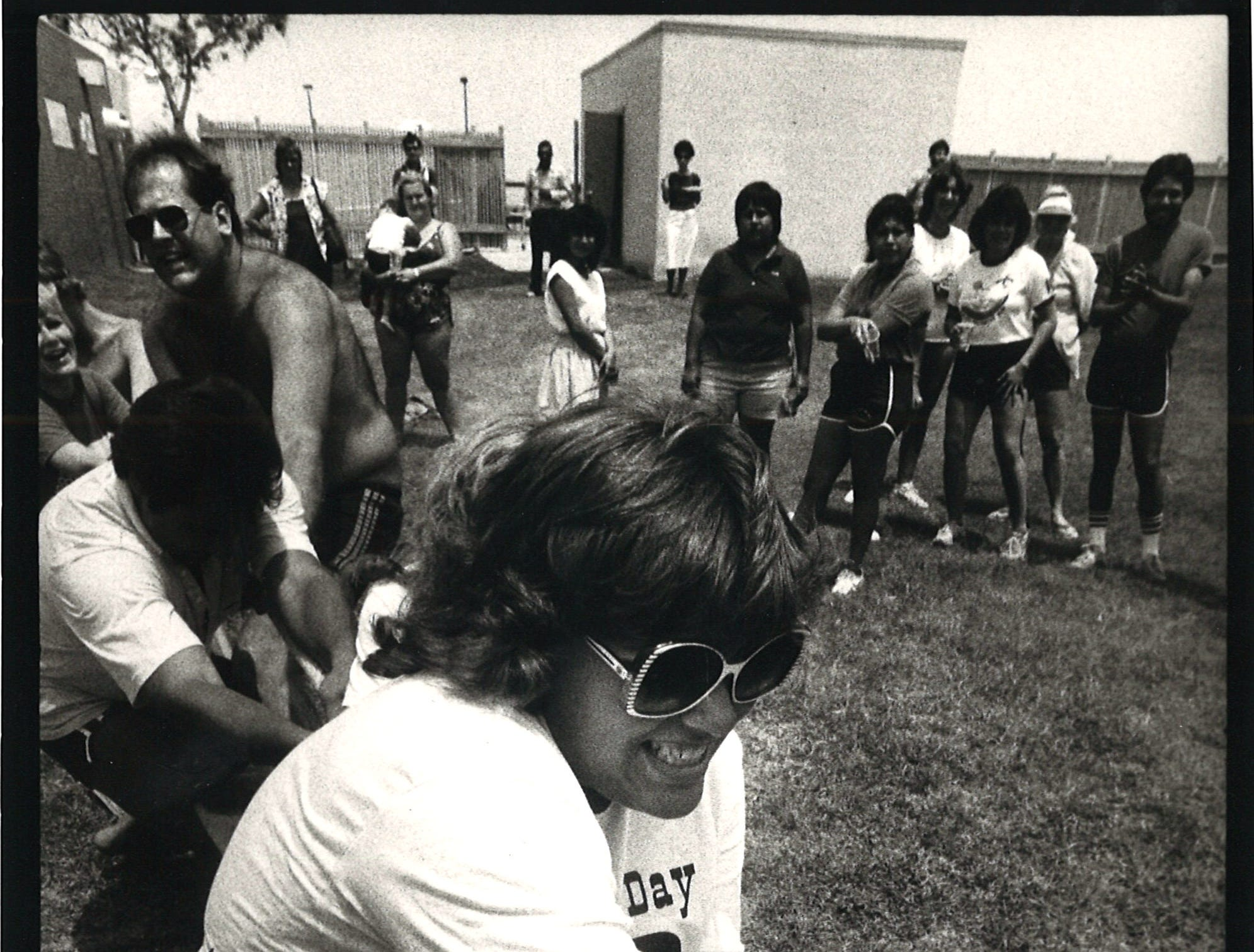 Neva Reaves struggles to help her team in the tug-of-war competition during Splash Day at Corpus Christi State University on April 27, 1983. Splash Day marks the official opening of the school's pool.