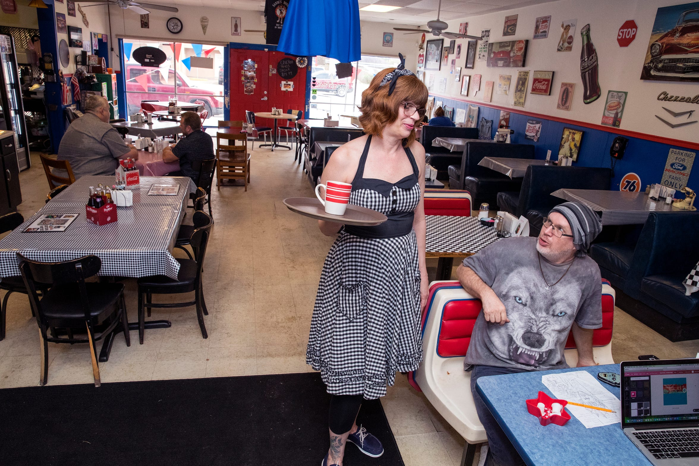 Sandi Clark, owner of Sandi's Diner on Ayers Street, talks with customer Eric Payne at the diner on Wednesday, February 6, 2019. The diner is hosting a grand reopening on Friday to celebrate six years of business.