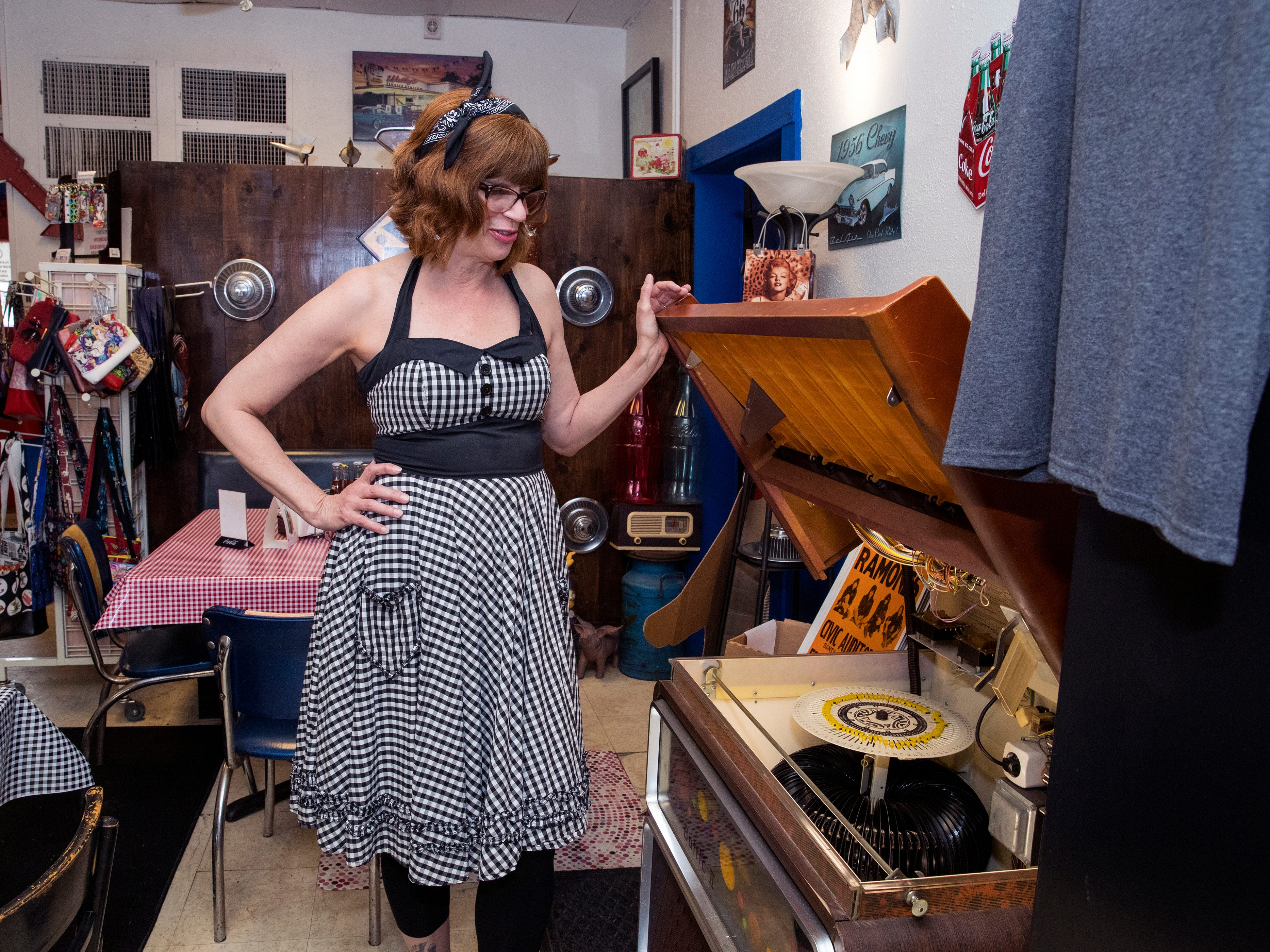 Sandi Clark, owner of Sandi's Diner on Ayers Street, shows off some of the unique items at the diner on Wednesday, February 6, 2019. The diner is hosting a grand reopening on Friday to celebrate six years of business.