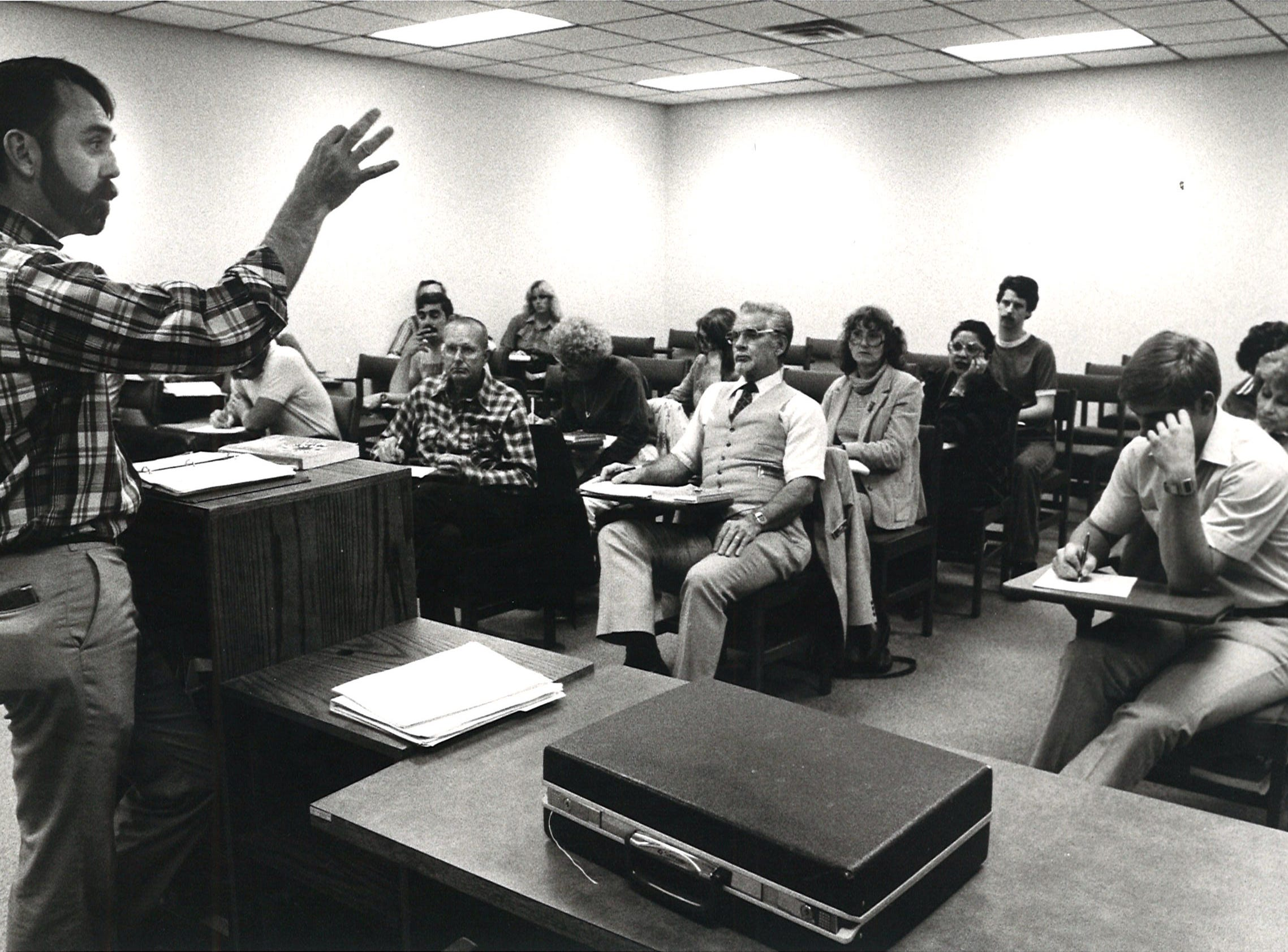 Professor of Communications John Wilson lectures during his Nonverbal Communications class on April 7, 1983 at Corpus Christi State University.