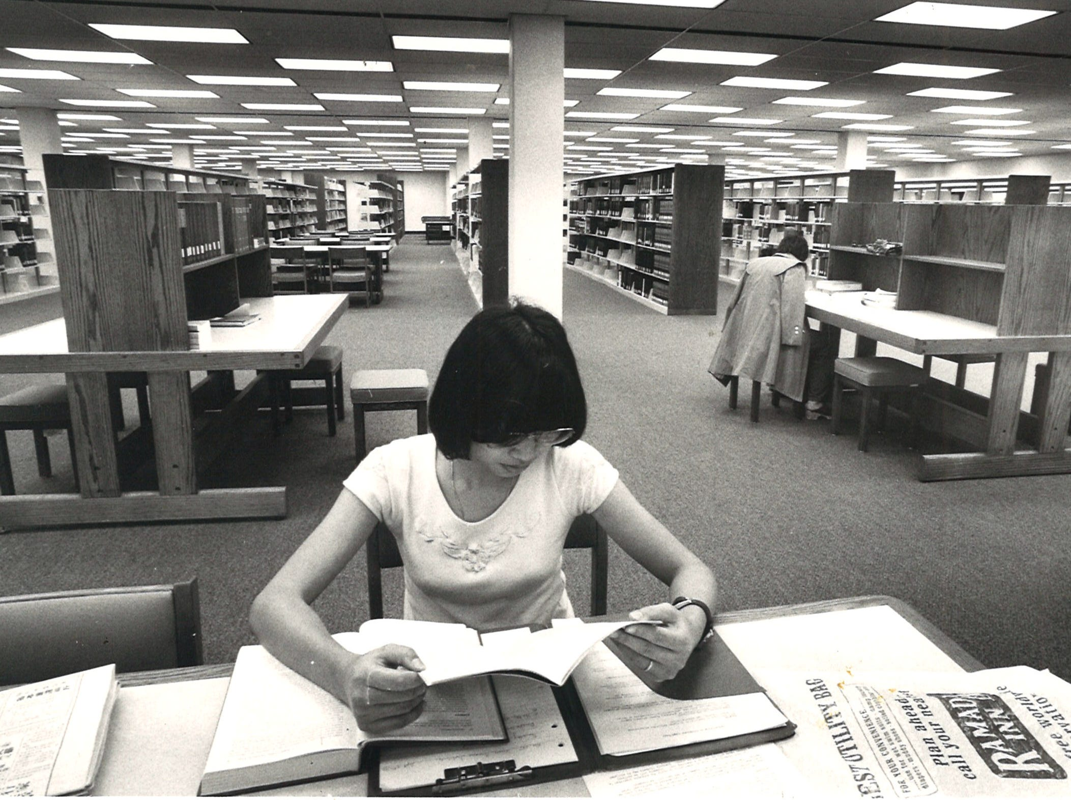 Corpus Christi State University student Kwan Ng studies in the new library on campus in September 1978.