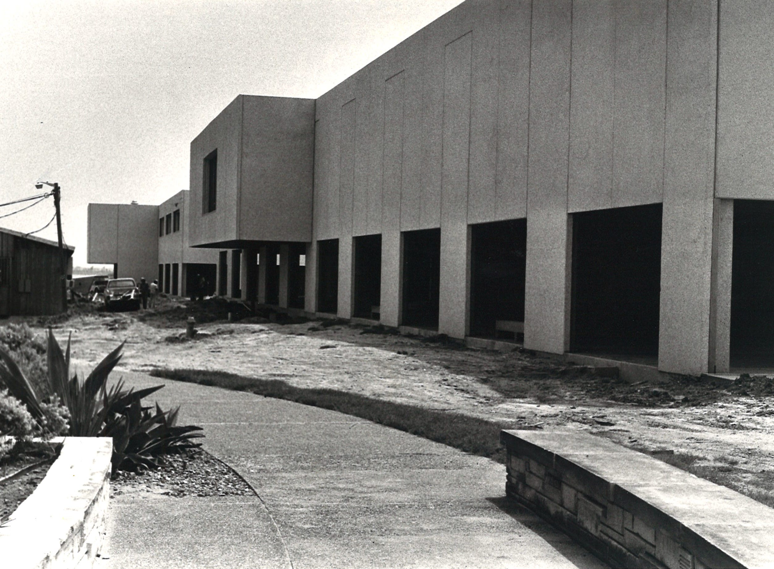 """The new library at Corpus Christi State University under construction in August 1978. The $2.9 million building was 109,000 square feet, more than five times the size of the previous library in """"the round building."""""""