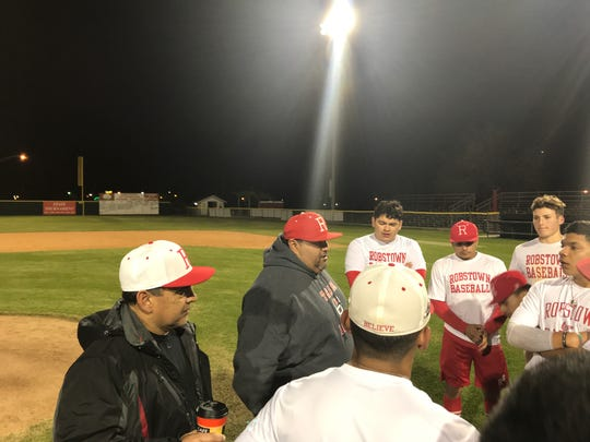 Robstown co-head baseball coach Elias Vasquez talks to the team after a practice at Steve Castro Field in Robstown.