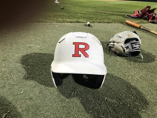 A Robstown baseball helmet sits on the turf at Steve Castro Field.