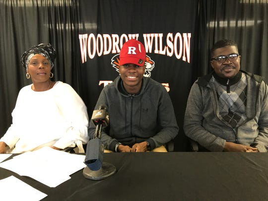 Woodrow WIlson senior Stanley King, center, sits with his mother Pippa Blanton, left, and father Charles King, after announcing he'd play football at Rutgers University this fall.