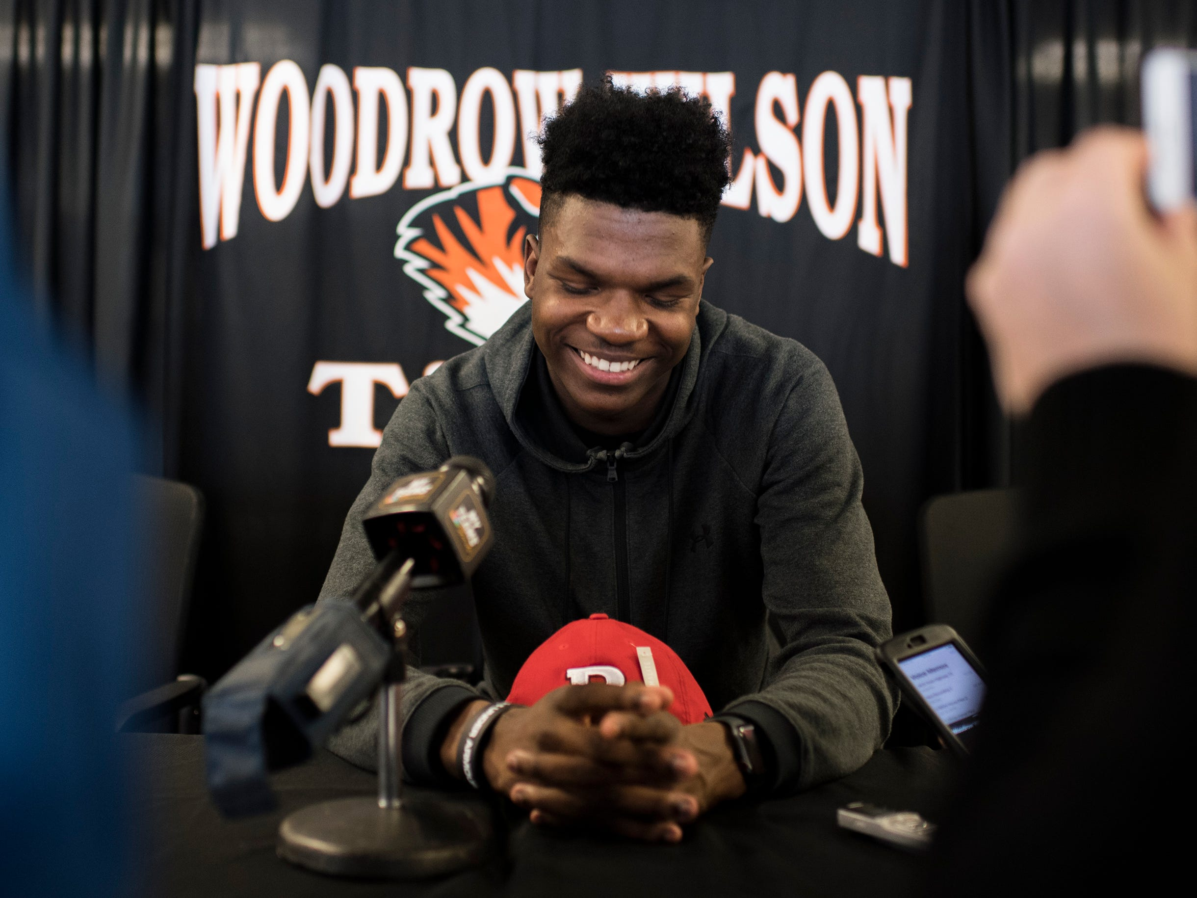 Woodrow Wilson wide receiver Stanley King smiles while speaking with media following his announcement to play for Rutgers University Wednesday, Feb. 6, 2019 at Woodrow Wilson High School in Camden, N.J.