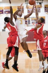 Glassboro's Keon Sabb puts up a shot between Penns Grove's Michael Wilson, left, and Penns Grove's Kavon Lewis during the 1st quarter of the boys basketball game played at Glassboro High School on Tuesday, February 5, 2019.  Glassboro defeated Penns Grove, 55-39.