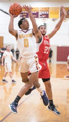 Glassboro's Kwandel Tokley puts up a shot next tp Penns Grove's Jaylen Newton during the 1st quarter of the boys basketball game played at Glassboro High School on Tuesday, February 5, 2019.  Glassboro defeated Penns Grove, 55-39.