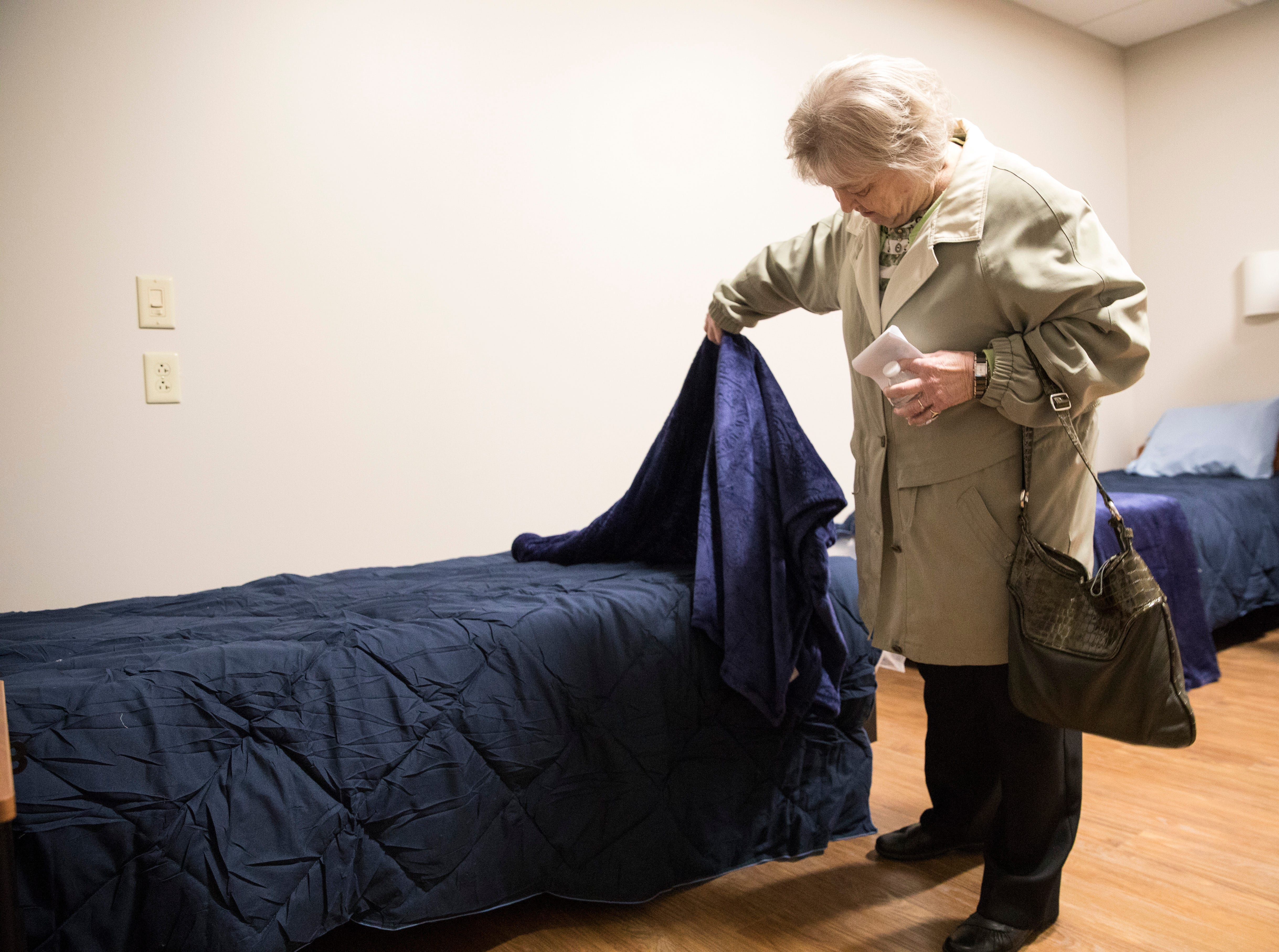 Scioto Paint Valley Mental Health Center board member Marsha Rulon looks at one of the 36 beds at a new residential alcohol and other drug treatment center for men on Feb. 5, 2019. The treatment center, located at 400 Chamber Drive, is named for Rulon who began volunteering with Scioto Paint Valley's crisis center in 1981 and is celebrating her 36th year on the board this year.
