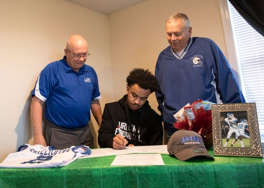 Chillicothe senior Adrian Beverly signed his letter of intent to play football at Urbana University at his home in Chillicothe, Ohio, with his former football coaches Ron Hinton and Jeff Arndt in attendance, along with his friends and family, to coincide with National Signing Day.