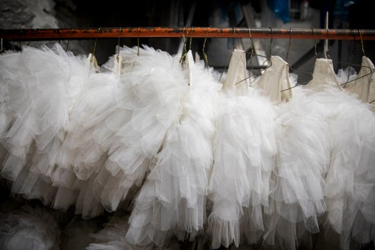 Tutus hang in the costume storage area of the Cincinnati Ballet Wednesday, January 16, 2019. Tutus made their debut in 1832 at the Paris Opera.