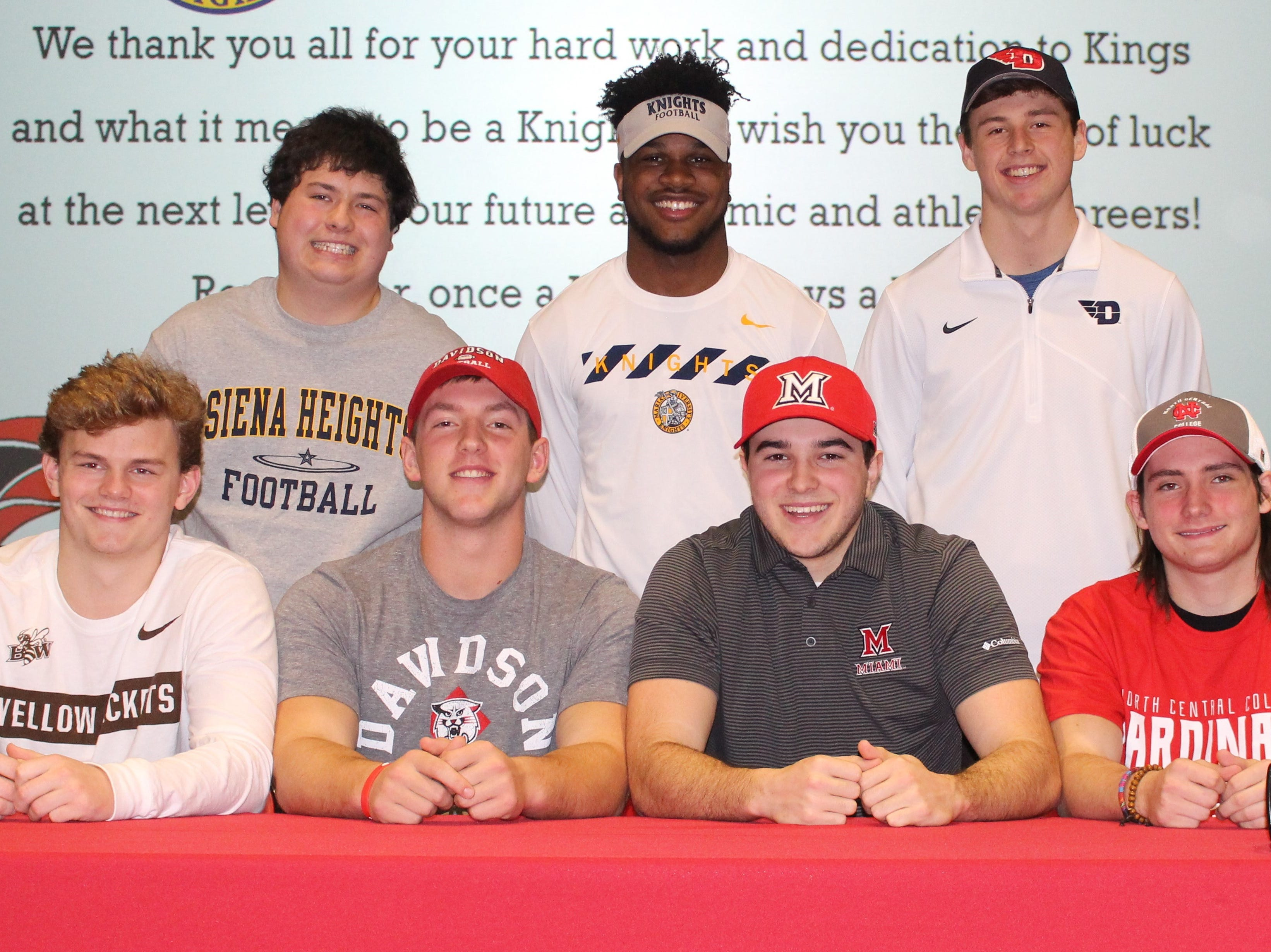 Kings High School had its Signing Day ceremony Feb. 6 for athletes committing to play sports in college. They are, from left: front,  Jacob Elam, football, Baldwin Wallace University; Jake Stylski, football, Davidson College; Brendan Beattie, football, Miami University-Oxford; Tommy Mitchell, football, North Central College; back, Logan Schmidt, football, Siena Heights University; Nak'emon Williams, football, Marian University; Ashton Koller, football, University of Dayton.