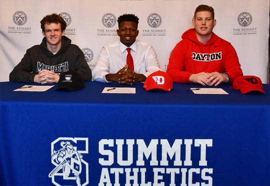 Summit Country Day seniors, from left, Dane Barker (Marietta lacrosse), Alonzo Motley (Dayton football) and Connor Woodruff (Dayton football) made their college choices official on Wednesday, Feb. 6.