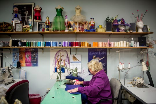 Cincinnati Ballet Wardrobe Mistress Diana Vandergriff-Adams sews a costume in the wardrobe department in the basement of the Cincinnati Ballet in the West End Wednesday, January 16, 2019.