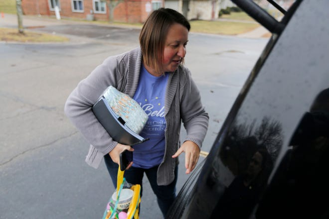 Every Child Succeeds supervisor Mindy Heathcoat Maurer packs up supplies and toys on a weekly visit to Ashley Ohmart, a young mother living in the Westwood neighborhood of Cincinnati. Gov. Mike DeWine wants to triple the number of women receiving home visits.