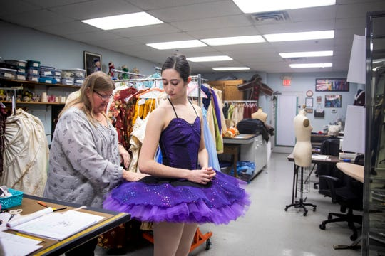 Cincinnati Ballet Wardrobe Assistant Lauren Hofmann fits the costume for Chelsea Thronson, a second company dancer, for Sleeping Beauty in the Cincinnati Ballet wardrobe department Wednesday, January 16, 2019.