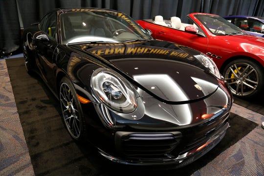 A 2018 Porsche 911 Turbo S at the Cincinnati Auto Expo inside the Duke Energy Convention Center in downtown Cincinnati on Wednesday, Feb. 6, 2019.