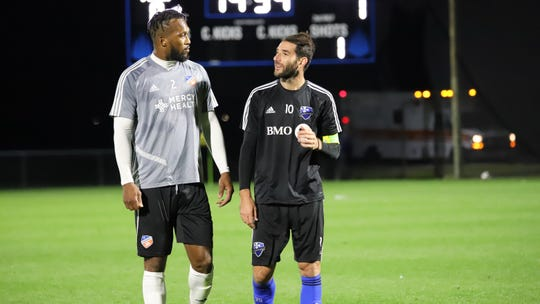 Kendall Waston (left) speaks with a player from the Montreal Impact during a 1-1 scrimmage draw at IMG Academy.