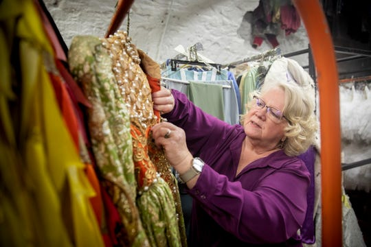 Cincinnati Ballet Wardrobe Mistress Diana Vandergriff-Adams shows an old costume in the costume storage area of the Cincinnati Ballet Wednesday, January 16, 2019.
