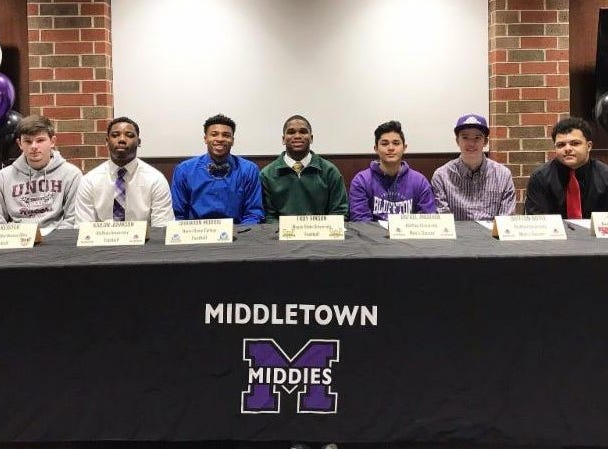 Middletown athletes signed to play college sports Feb. 6. Those signing were, from left: Kyle Keister, baseball, University of Northwest Ohio; Kailon Johnson, football, Bluffton; Shandon Morris, football, Notre Dame College; Troy Vinson, football, Wayne State; Rafael Andrade, soccer, Bluffton; Britton Boyle, soccer, Bluffton; and John Caldwell, football, Kentucky Christian.