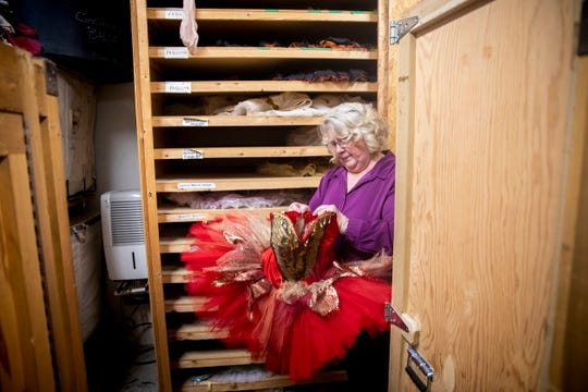 Cincinnati Ballet Wardrobe Mistress Diana Vandergriff-Adams pulls out a tutu she designed for the Cincinnati Ballet Wednesday, January 16, 2019.
