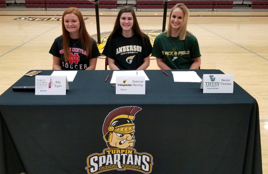 Turpin honored the following athletes who signed their letters of intent to play college sports. They are, from left: Kily Egan, soccer, North Central College;  Spencer Heming, soccer, Anderson University; and Nicole Thomas, track and Field, Tiffin University.
