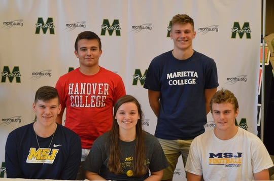 McNicholas athletes signed to play college sports Feb. 6. They are, from left: front, Nate Chambers, soccer, Mount St. Joseph University; Maggie Schoolfield, basketball, Mount St. Joseph University; Chris Walter, football, Mount St. Joseph University; back, Michael Schaeper, lacrosse, Hanover College and Bryce Kellerman, basketball, Marietta College.