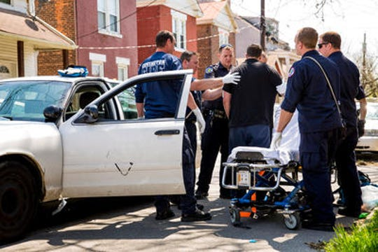 Paramedics respond to an overdose in Covington, Northern Kentucky. The individual's car had stopped in the street. It was still in gear.