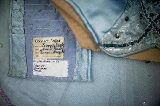 The original tag for the Sleeping Beauty costume has the names of the dances written on them in marker.