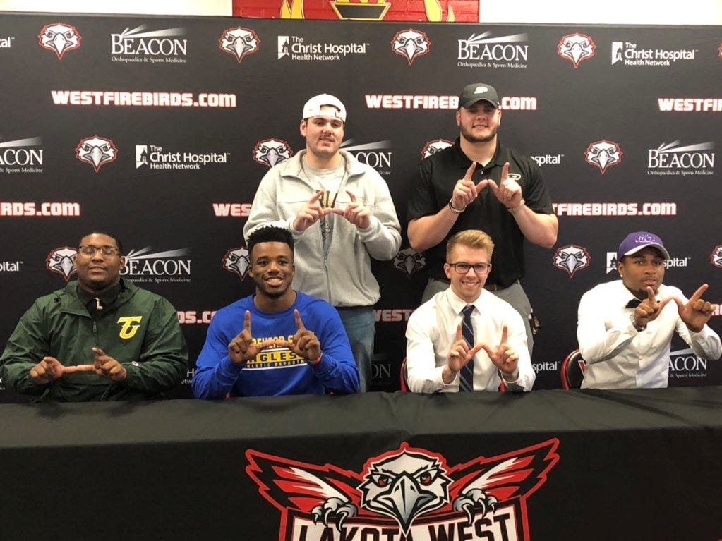 Lakota West football players signed their letters of intent to play college sports Feb. 6. They are, from left: front, LaDonnis Griffin, Tiffin; Jalen Swanson, Morehead State; Nick Hjort, Ohio Dominican; Terrance Owensby, Bluffton; back, Ryan Francisco, Marian; Steven Faucheux, Purdue (early signee).