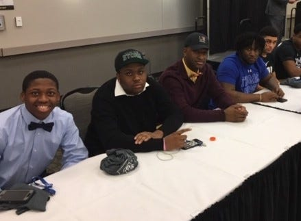 Fairfield football players signed to play college sports. They are, from left: Allen Caldwell. Pikeville; Mekiyell Muhammad, Lake Erie College; Jeff Tyus, Charleston; Greg Fitzpatrick, Thomas More; Peyton Brown, Lake Erie College; Del Thomas, Thomas More; and Jacob Hensley, East Tennessee State. Erick All, not pictured, is already enrolled at the University of Michigan