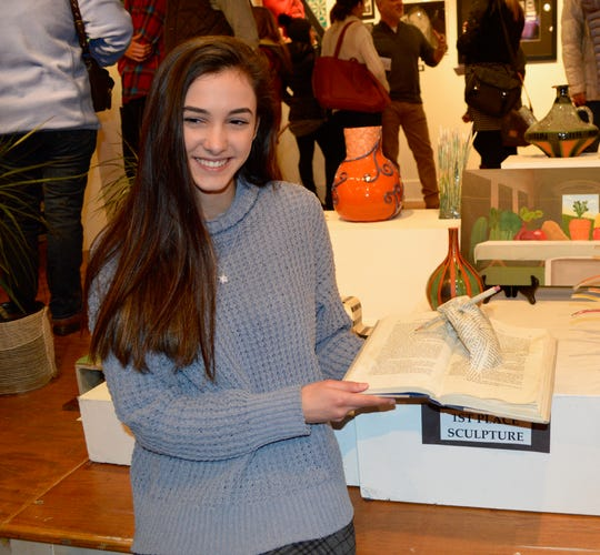 """Jeanna Woodell, senior at Hunterdon Central High School won first place 3-D, """"Altered Book"""" found materials"""