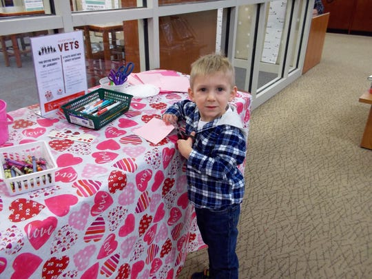 Brandon Campbell, 3, of Hillsborough, crafts a Valentine for a veteran.