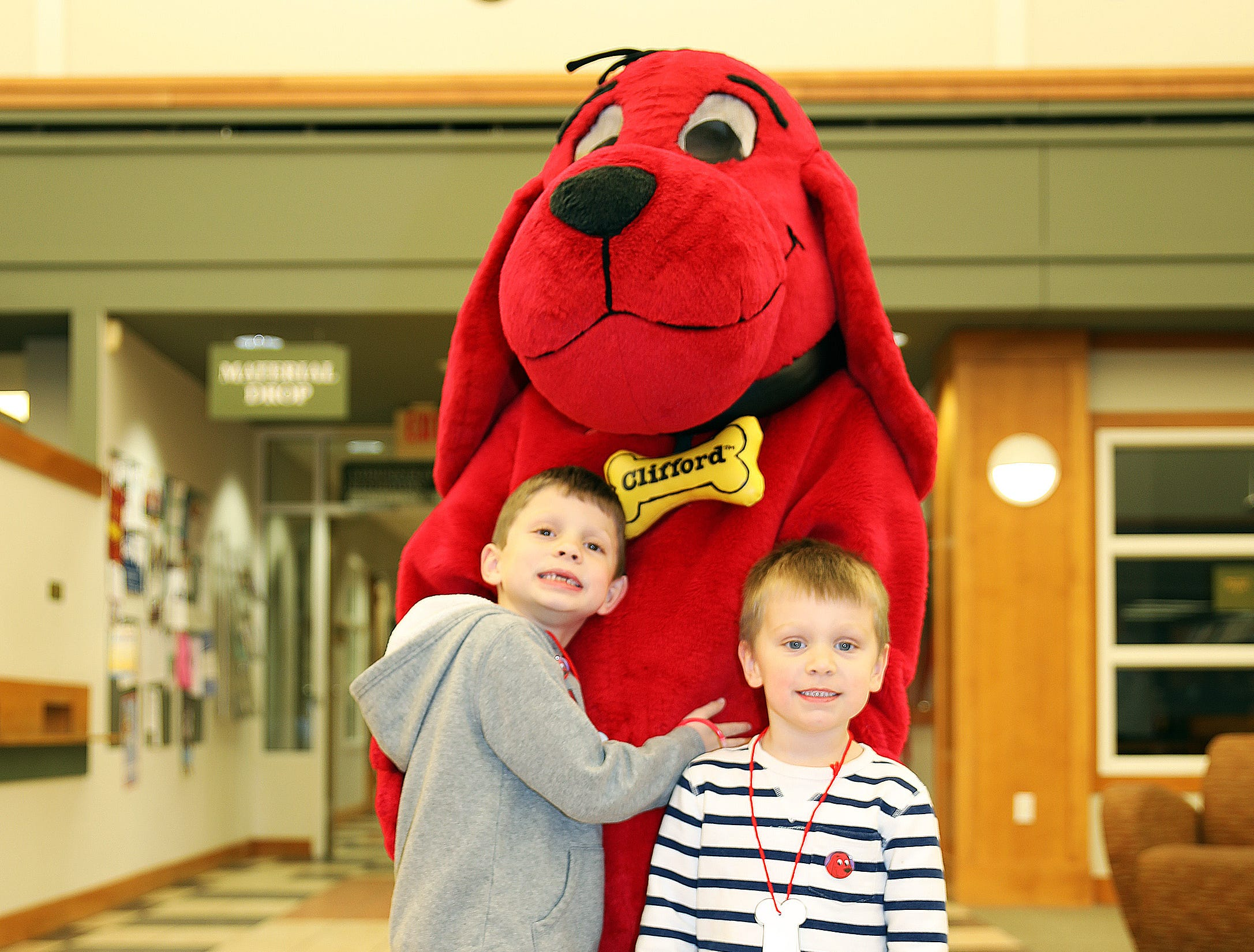 Zachary, 6, and Henry Robinson, 3, of Ankeny enjoy meeting Clifford the Big Red Dog at his birthday party at Kirkendall Public Library in Ankeny on Tuesday, Feb. 5, 2019.