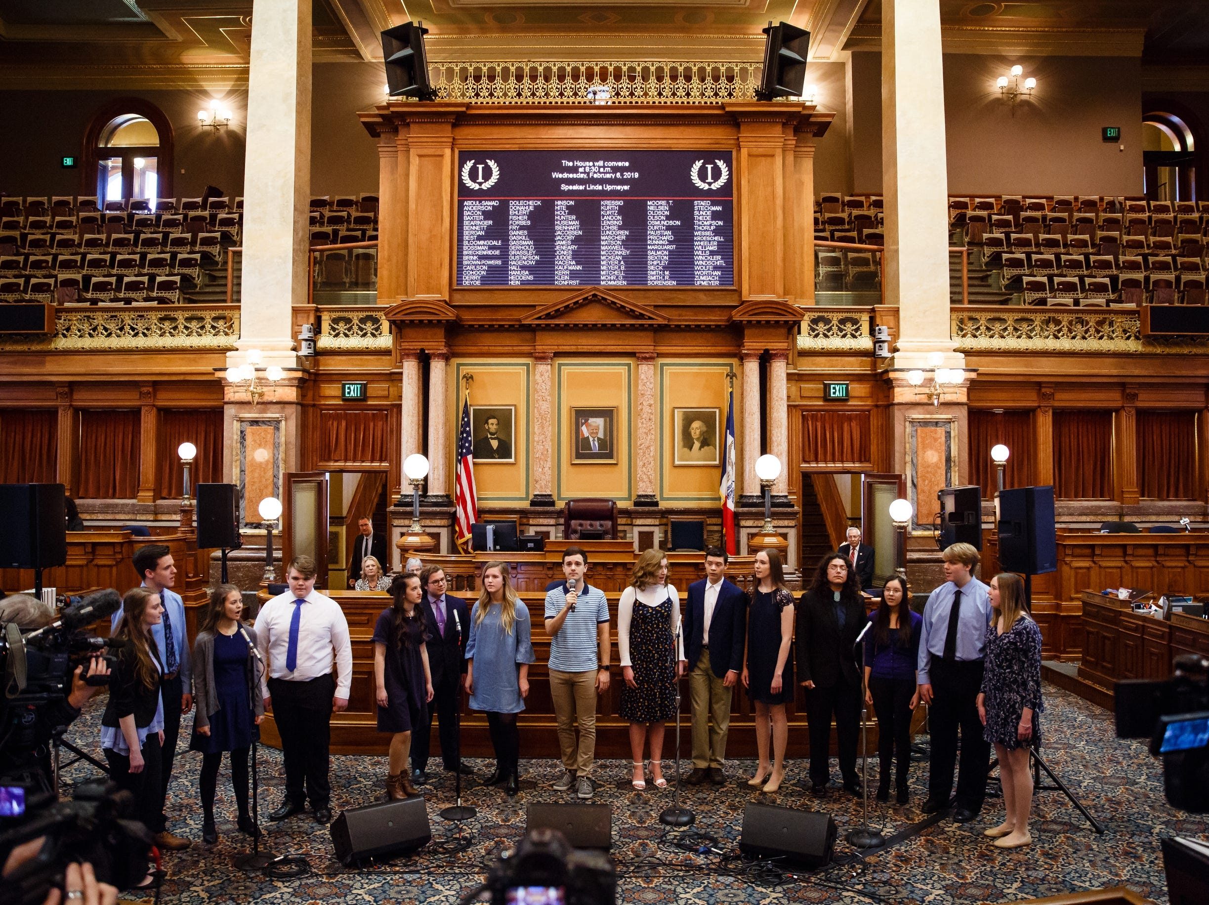 """Actor Stephen Christopher Anthony, center, striped shirt, performs the song """"You Will Be Found"""" from the Broadway show Dear Evan Hansen with the Waukee High School Avenue Jazz choir at the Iowa State Capitol on Wednesday, Feb. 6, 2019, in Des Moines."""