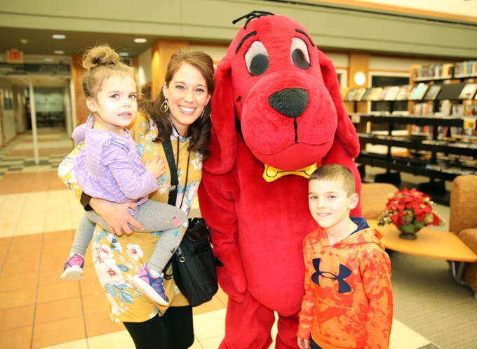 Lilly, 3, Evan, 6, and Emily Marusiak of Ankeny pose for a picture with Clifford the Big Red Dog during his birthday party at Kirkendall Public Library in Ankeny on Tuesday, Feb. 5, 2019.