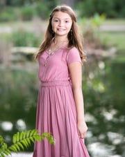 Ava Norton, age 9