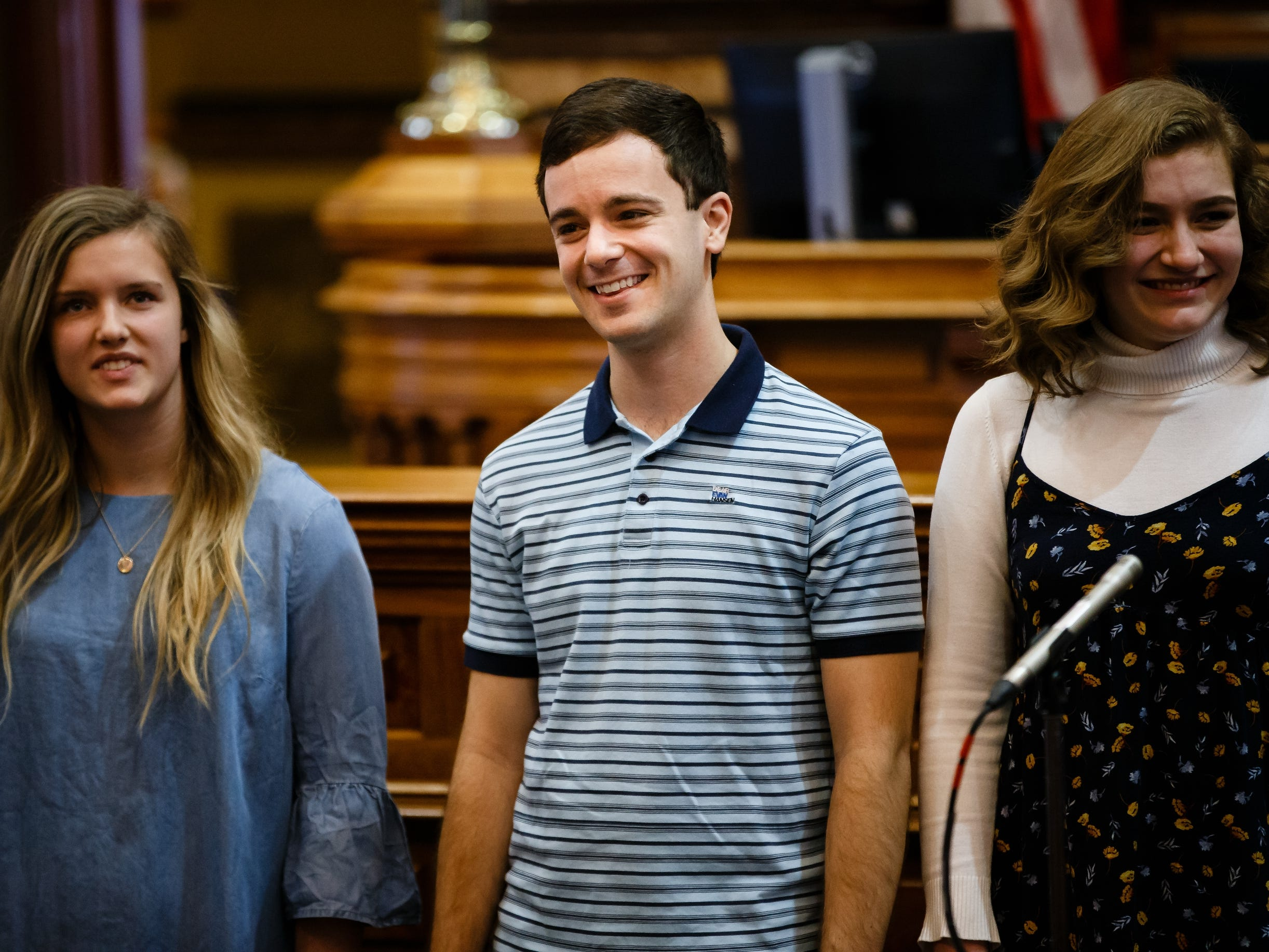 """Actor Stephen Christopher Anthony, center, performs the song """"You Will Be Found"""" from the Broadway show Dear Evan Hansen with the Waukee High School Avenue Jazz choir at the Iowa State Capitol on Wednesday, Feb. 6, 2019, in Des Moines."""