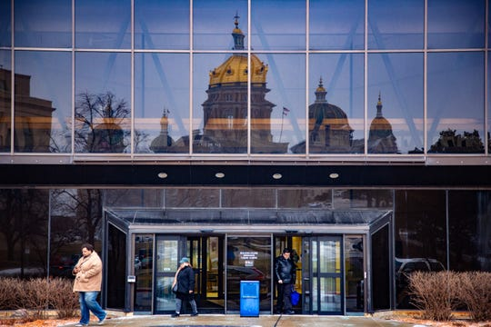 The Iowa Capitol is reflected in the Hover Building, home of the Iowa Department of Revenue, on Wednesday, Feb. 6, 2019.