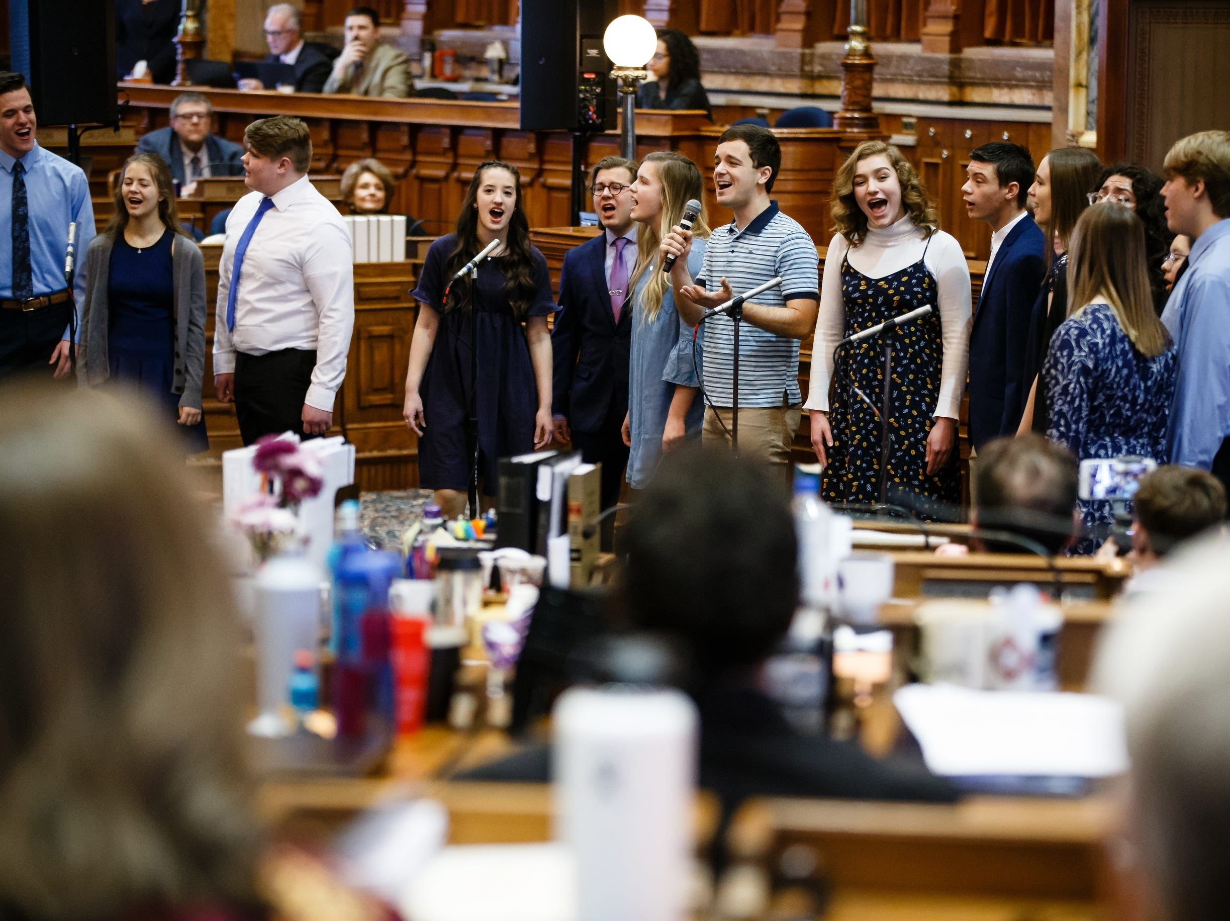 "Actor Stephen Christopher Anthony, center, striped shirt, performs the song ""You Will Be Found"" from the Broadway show Dear Evan Hansen with the Waukee High School Avenue Jazz choir at the Iowa State Capitol on Wednesday, Feb. 6, 2019, in Des Moines."