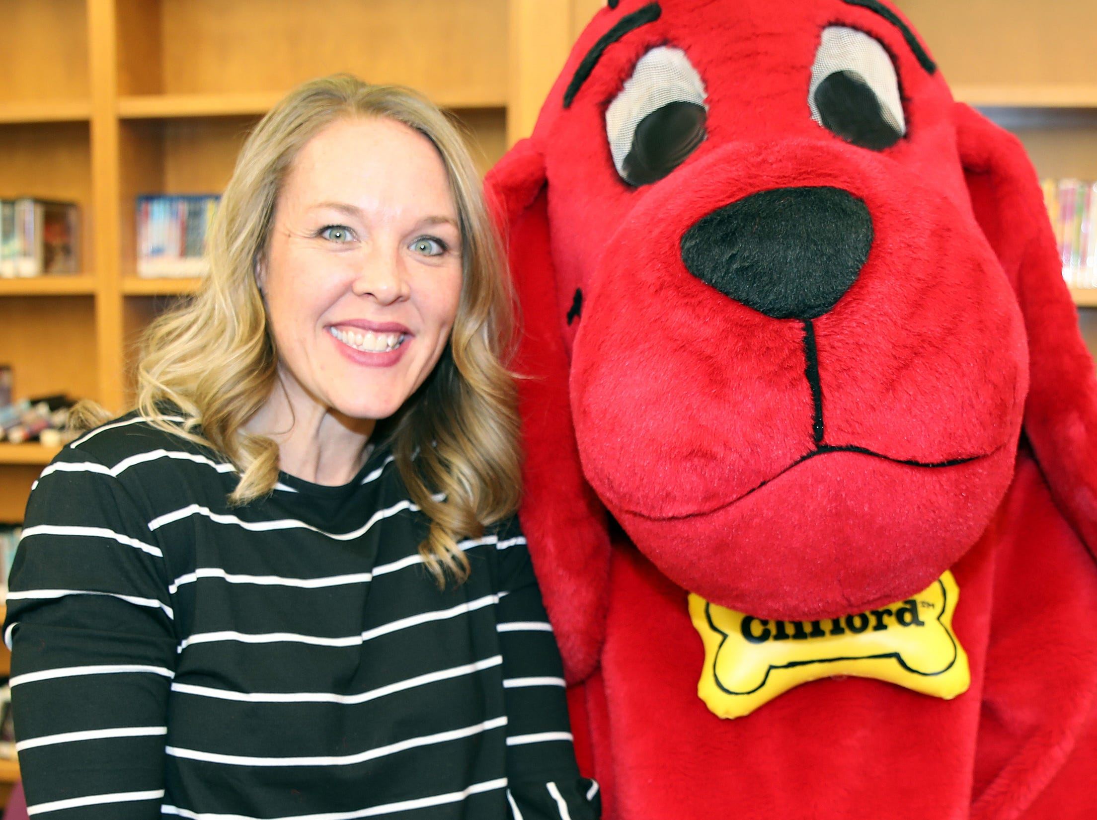Children's Librarian Kelly Munter poses for a photo Clifford the Big Red Dog during his birthday Party at Kirkendall Public Library in Ankeny on Tuesday, Feb. 5, 2019.