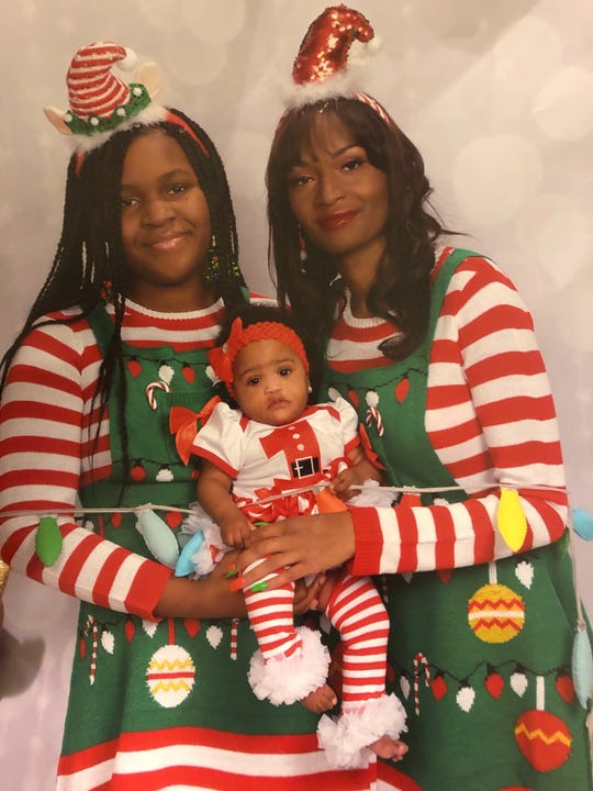 Dana Morrison with her baby Nahla, and 13-year-old daughter, Ny'Asiah.