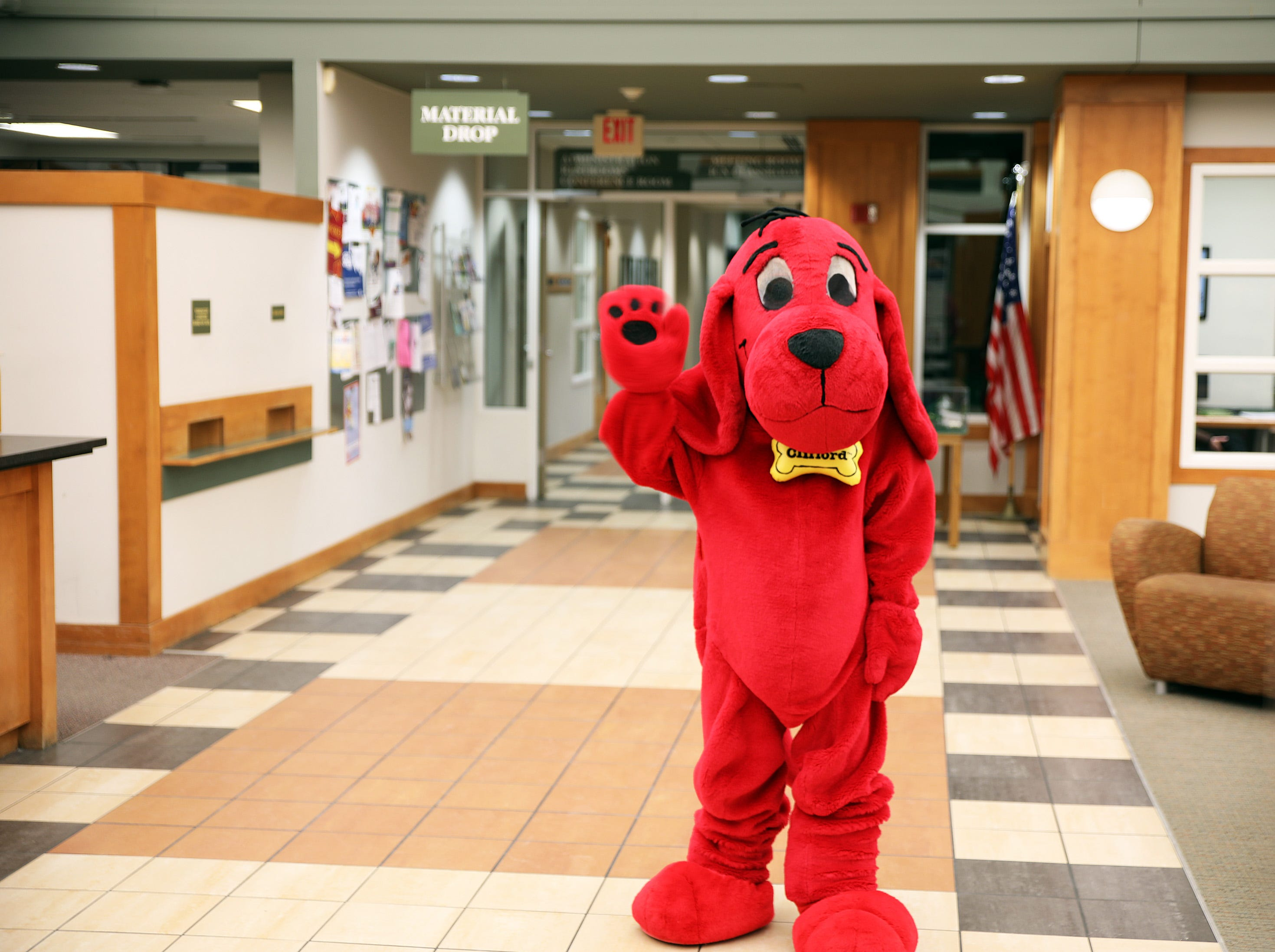 Clifford the Big Red Dog waves goodbye at the end of his birthday party at Kirkendall Public Library in Ankeny on Tuesday, February 5, 2019.
