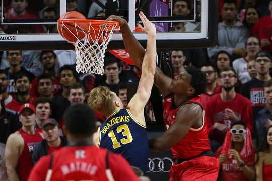Shaquille Doorson #2 of the Rutgers Scarlet Knights dunks over Ignas Brazdeikis #13 of the Michigan Wolverines during the first half of a game at Rutgers Athletic Center on February 5, 2019 in Piscataway, New Jersey.