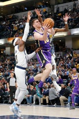 Los Angeles Lakers forward Sviatoslav Mykhailiuk (10) shoots the ball past Indiana Pacers guard Aaron Holiday (3) during the fourth quarter at Bankers Life Fieldhouse on Feb. 5, 2019.