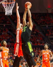 Michigan State forward Xavier Tillman shoots defended by Illinois forward Giorgi Bezhanishvili during the second half of MSU's 79-74 loss to Illinois on Tuesday, Feb. 5, 2019, in Champaign, Ill.