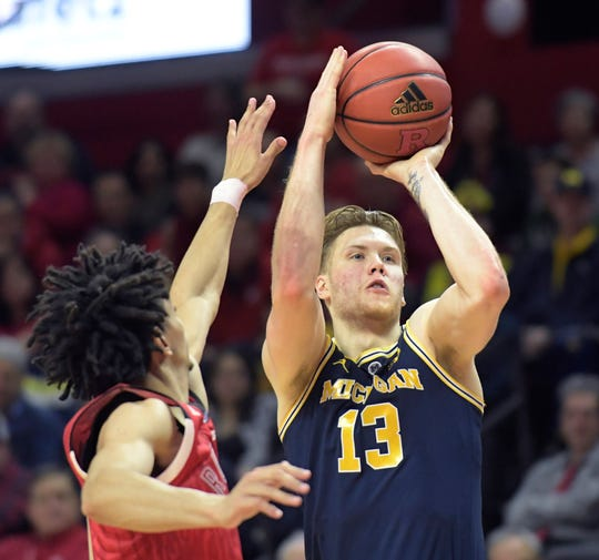 Michigan forward Ignas Brazdeikis shoots as Rutgers guard Geo Baker defends during the second half of U-M's 77-65 win on Tuesday, Feb. 5, 2019, in Piscataway, N.J.