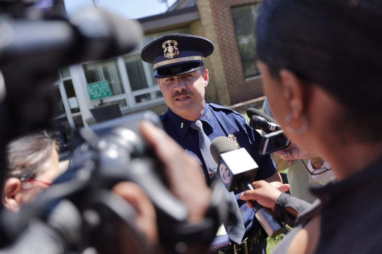 Michigan State Police 1st Lt. Mike Shaw has been nearly hit by vehicles four times, while colleagues have experienced worse. Here he talks with reporters outside of the 22nd District Court on July 3, 2014.
