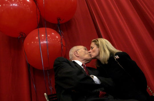Rep. John Dingell, D-Mich., receives a kiss from his wife, Debbie, just before the start of a celebration marking 50 years of service in the House of Representatives at the Ford Community and Performing Arts Center in Dearborn, Mich., on Oct. 16, 2005. The Dearborn Democrat and his wife Debbie, who now holds his seat, were a powerhouse couple in Washington.